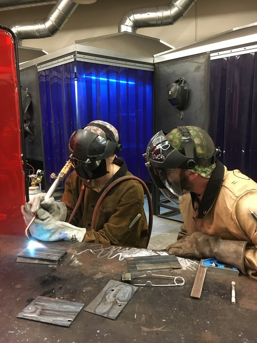 Student Monica practices her welds.