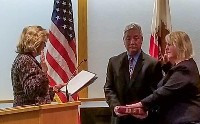 Mary Sakuma being sworn in