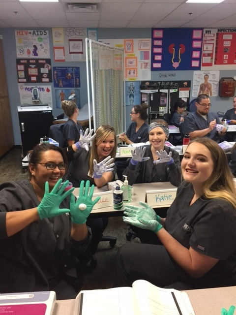 Students practice skills with surgical gloves