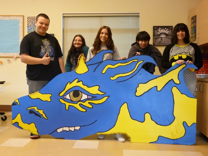 students with dragon cut out