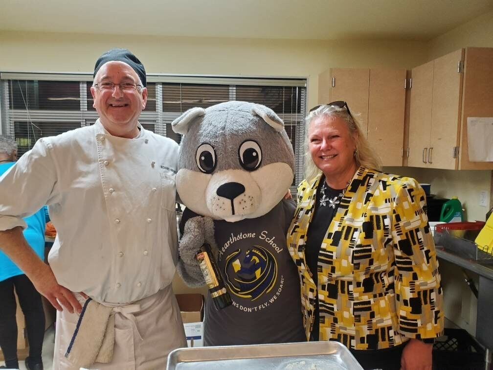 Chef Richie, Chewy the Squirrel, and BCOE Superintendent Mary Sakuma