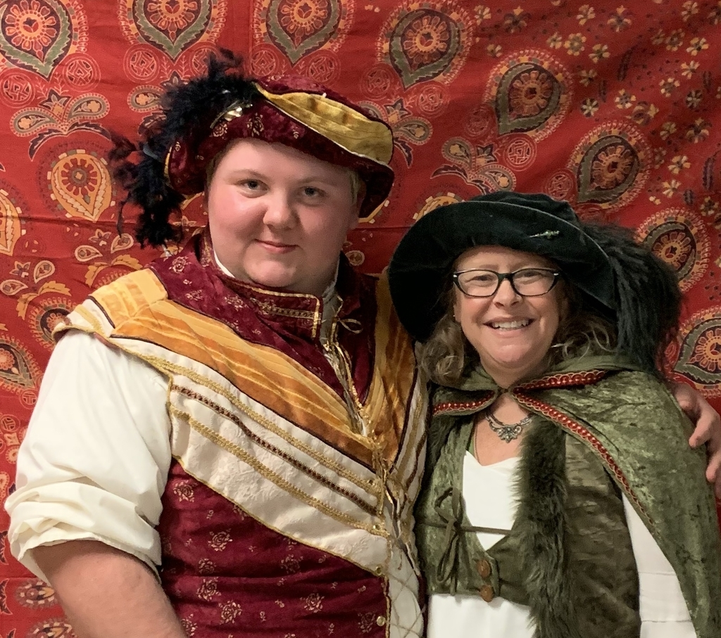 Two people dressed in Shakespearean costumes