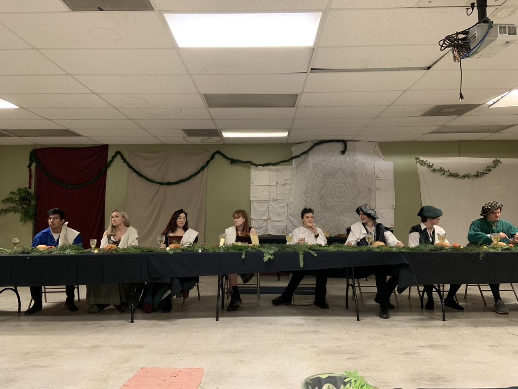 Shakespeare students sitting at banquet table
