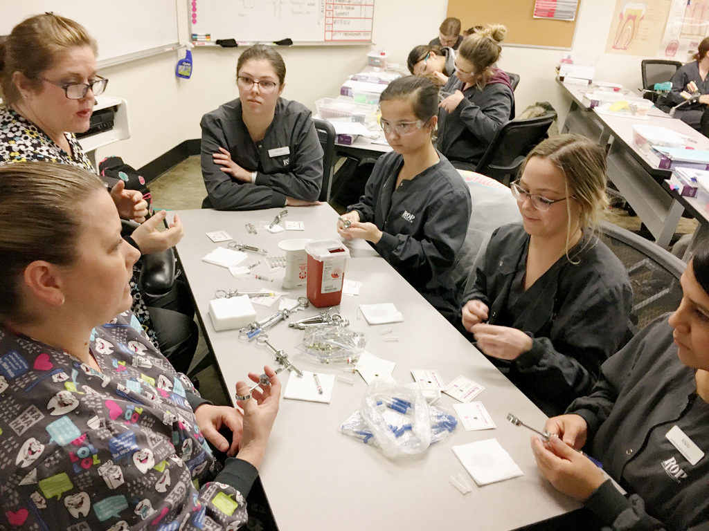 Students learn about re-capping techniques with instructors Colleen and Jami.