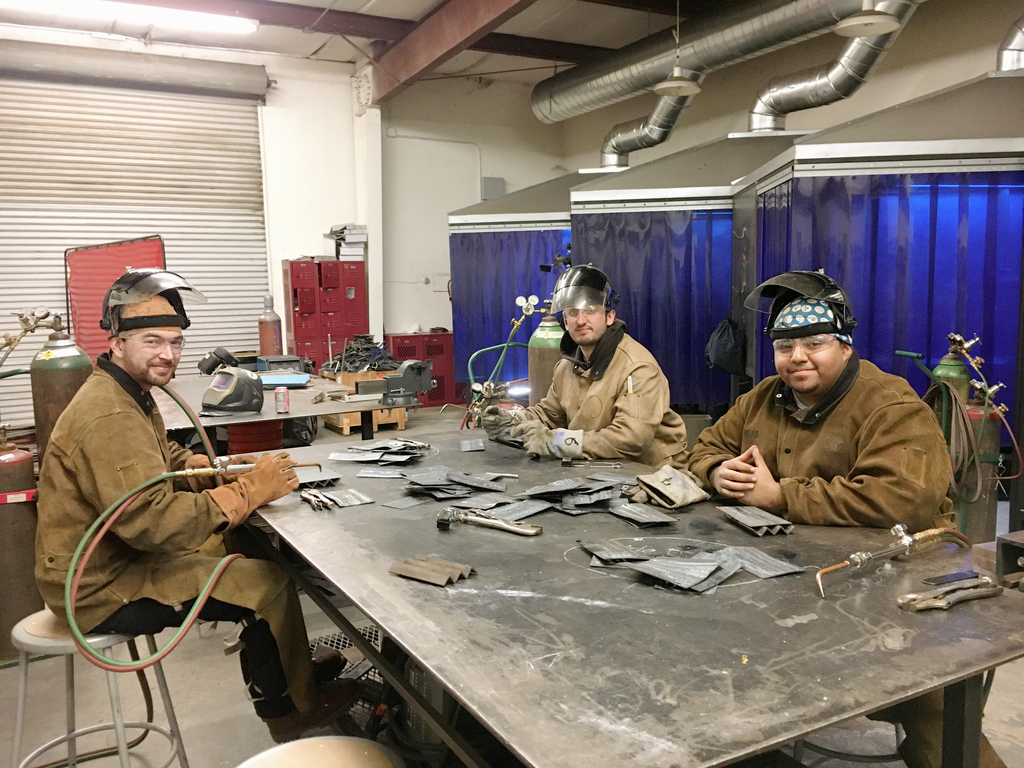 Three students in our welding class start their work day